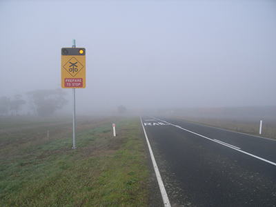 Fog obstructing view of level crossing